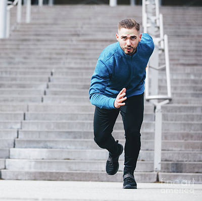 Photograph - Handsome Sportsman Running In Athletic Clothes by Michal Bednarek