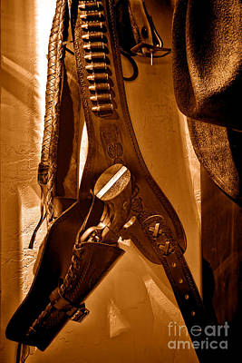 Cowboy Hat Photograph - Hanging Revolver - Sepia by Olivier Le Queinec