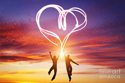 Silhouetted Photograph - Happy Couple In Love Jump Making Heart Symbol Of Light by Michal Bednarek
