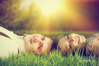 Retro Photograph - Happy Couple In Love Smiling While Lying On Summer Grass by Michal Bednarek