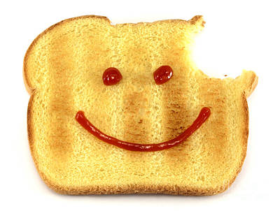Funny Signs Photograph - Happy Face And Bread by Blink Images