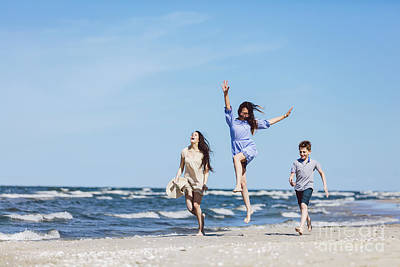 Photograph - Happy Family Having A Good Time On The Beach. by Michal Bednarek