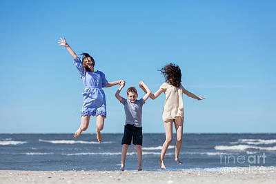 Photograph - Happy Family Jumping High On The Seashore. by Michal Bednarek