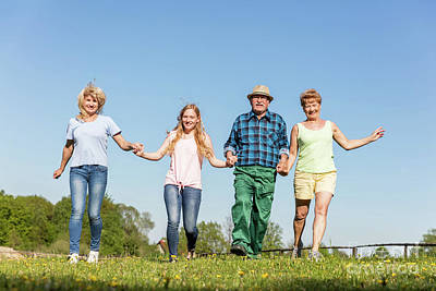 Photograph - Happy Family Running On The Field. Generations by Michal Bednarek