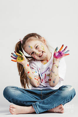 Photograph - Happy Girl Covered In Paint Sitting On The Floor. by Michal Bednarek