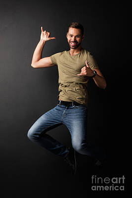 Relaxation Photograph - Happy Handsome Young Man Jumping And Dancing by Michal Bednarek