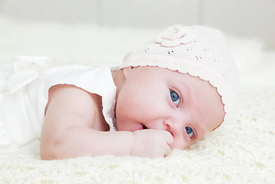 Adorable Photograph - Happy Newborn Baby Portrait, Looking At The Camera With Her Blue Big Eyes. by Michal Bednarek
