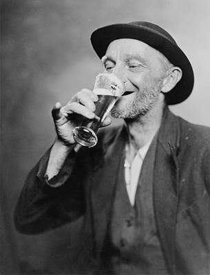 20th Century Photograph - Happy Old Man Drinking Glass Of Beer by Everett
