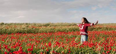 Nirvana - Happy Teenage Girl  in a red field of poppy flowers  by Michalakis Ppalis