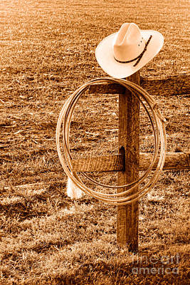 Fencepost Photograph - Hat And Lariat On A Post - Sepia by Olivier Le Queinec