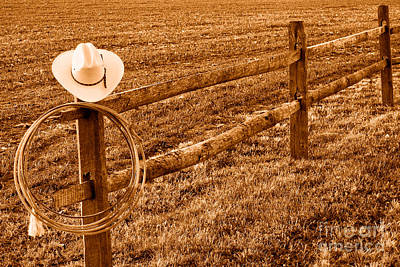 Fencepost Photograph - Hat And Lasso On Fence - Sepia by Olivier Le Queinec
