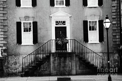 Photograph - Haunting Surreal Black And White Charleston South Carolina French Quarter Architecture Windows Door by Kathy Fornal