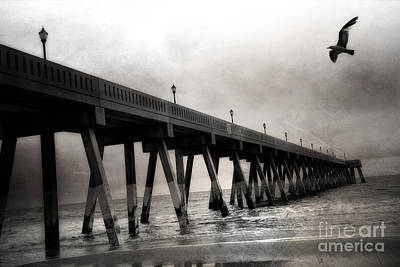 Photograph - Haunting Surreal Spooky Wrightsville Beach Ocean Pier Bridge With Raven Black And White Print Decor by Kathy Fornal