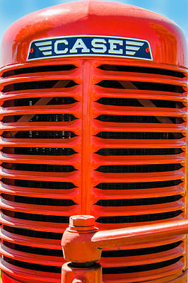 Photograph - Head On To An Old Case Tractor Grill In Classic Orange Paint by John Brink