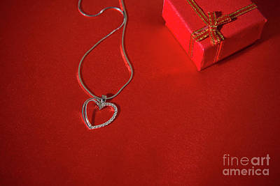 Sterling Pendant Photograph - Heart Pendant On A Red Satin Background by Luigi Morbidelli