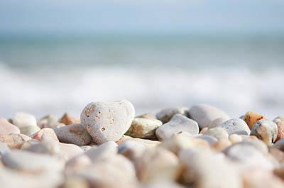 Heart Shaped Pebble On The Beach Art Print by Alexandre Fundone