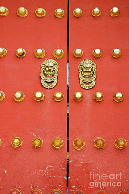 Heavy Ornate Door Knockers On A Gate Art Print by Sami Sarkis