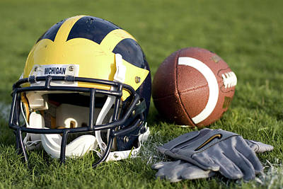 Photograph - Helmet On The Field With Football And Gloves by Michigan Helmet