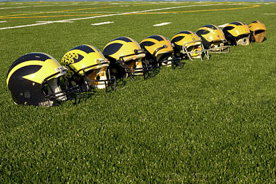 Photograph - Helmets Of Different Eras On The Field by Michigan Helmet