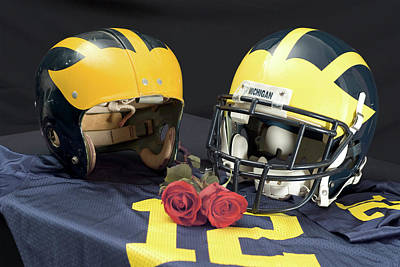 Photograph - Helmets Of Different Eras With Jersey And Roses by Michigan Helmet