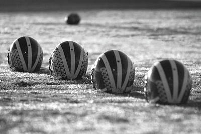 Helmets On Dew-covered Field At Dawn Black And White Art Print