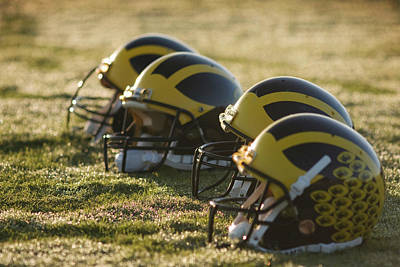 Photograph - Helmets On The Field At Dawn by Michigan Helmet