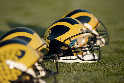Photograph - Helmets On The Field by Michigan Helmet