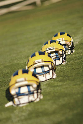 Photograph - Helmets On Yard Line by Michigan Helmet
