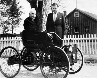 Ford Automobiles Photograph - Henry Ford Sits In His First Ford Car by Everett