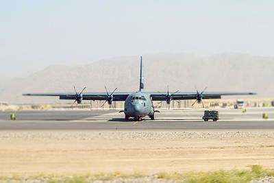 Photograph - Hercules C-130 On Runway by SR Green