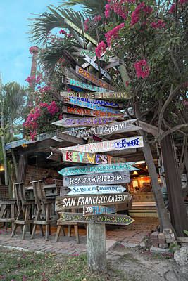 Beach Royalty-Free and Rights-Managed Images - Hogfish Bar and Grill Directional Sign by Betsy Knapp