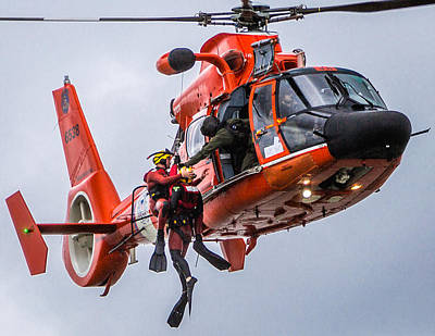 Photograph - Hoisting Into Helicopter by Gregory Daley  PPSA