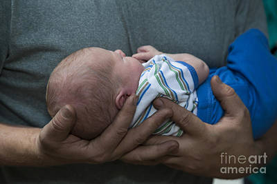 Photograph - Holding His Baby by Jim West