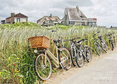 Photograph - Holland - Bicycles Parked Along The Fence by Gabriele Pomykaj