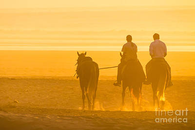 Horse Riding On The Beach At Sunset. Art Print by Matej Kastelic