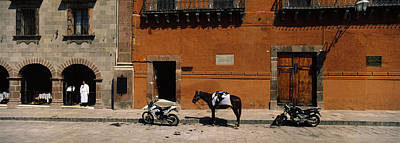 Horse Standing Between Two Motorcycles Art Print by Panoramic Images