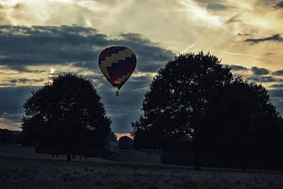 Photograph - Hot Air Balloon Between The Trees At Dusk by Scott Lyons