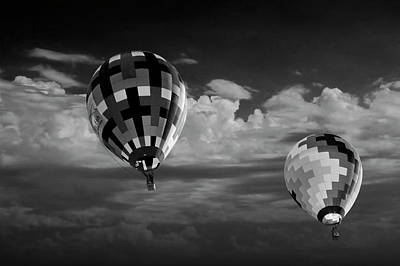 Photograph - Hot Air Balloons Against A Cloudy Sky In Black And White by Randall Nyhof