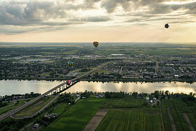 Photograph - Hot Air Balloons Flying Over Saint-jean-sur-richelieu In Quebec Canada by Georgia Mizuleva