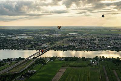 Photograph - Hot Air Balloons Flying Over Saint-jean-sur-richelieu In Quebec Canada by Georgia Mizuleva