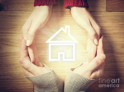 Photograph - House Symbol Inside Hands Circle. Concept Of Home Insurance by Michal Bednarek