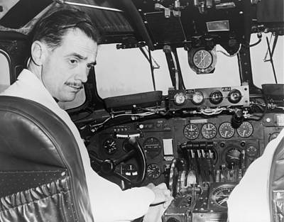 1940s Portraits Photograph - Howard Hughes Seated In The Cockpit Twa by Everett