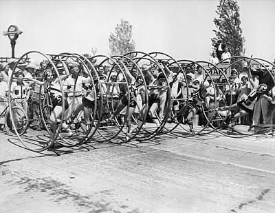 Human Hoop Race In La Art Print by Underwood Archives