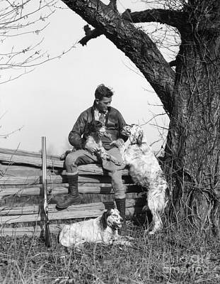 Pet Care Photograph - Hunter With Dogs, C.1920-30s by H. Armstrong Roberts/ClassicStock