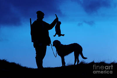 Photograph - Hunter With Hare At Sunset by Arterra Picture Library