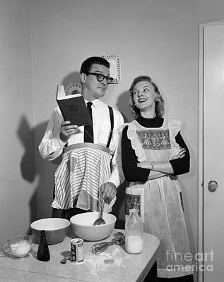 Mess Photograph - Husband Trying To Cook While Wife Looks by Debrocke/ClassicStock
