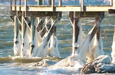 Photograph - Ice Covered Pilings by Karen Silvestri