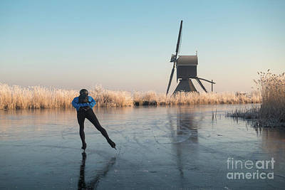 Ice Skating Past Frosted Reeds And A Windmill Art Print
