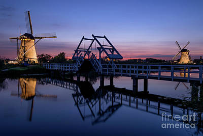 Photograph - Illuminated Windmills, A Bridge And A Canal At Sunset by IPics Photography