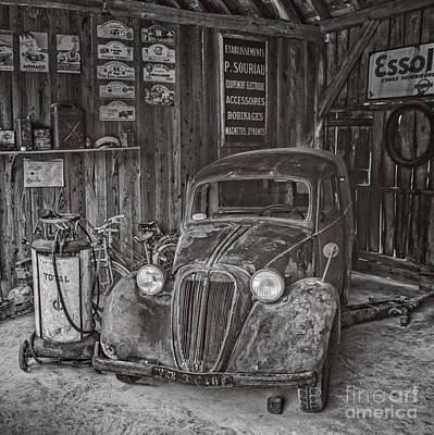 In The Old Garage Art Print by Edward Fielding